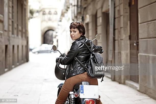female motorcyclist riding a vintage motorbike in european city centre - handlebar stock photos and pictures