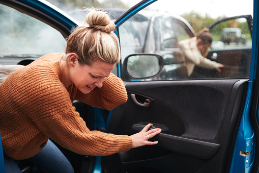 Female Motorist In Crash For Crash Insurance Fraud Getting Out Of Car 1156652573