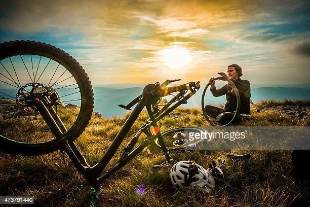 Female Mountain Biker Repairing her Bike