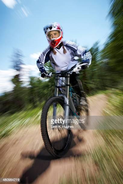 Female mountain biker speeding downhill