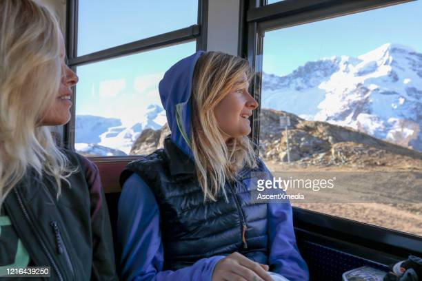 female mountain bikers look out train window - pinnacle peak stock pictures, royalty-free photos & images