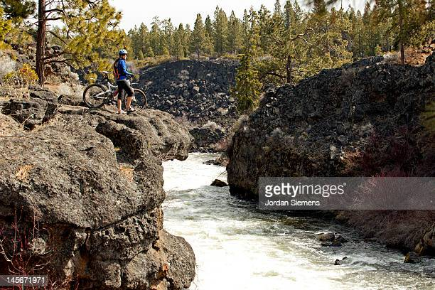 a female mountain biking. - bend oregon stock photos and pictures