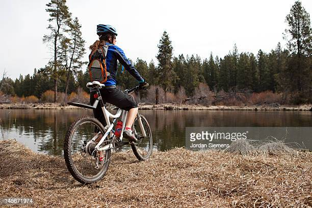 A female mountain biking.