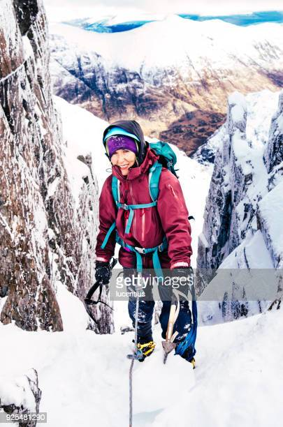 Female mountain climber on winter route