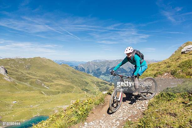 female mountainbiker at urdensee turn, switzerland - narrow stock pictures, royalty-free photos & images