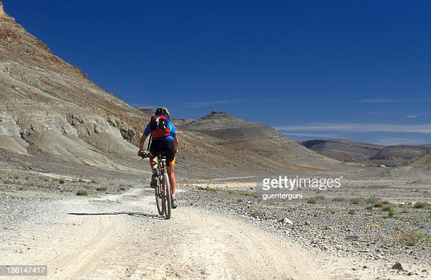 Female Mountainbiker in the mountain desert of Morocco