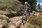 http://www.istockphoto.com/photo/female-mountainbiker-is-riding-on-a-narrow-single-trail-in-the-carinthian-mountains-gm840223422-136904805