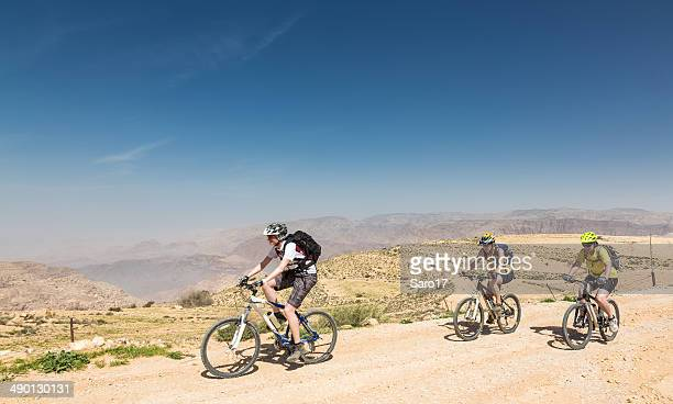 female mountainbikers in the jordan mountains - tinted sunglasses stock pictures, royalty-free photos & images