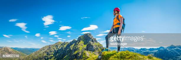 Female mountaineer on panoramic peak Aonach Eagach Glencoe Highlands Scotland