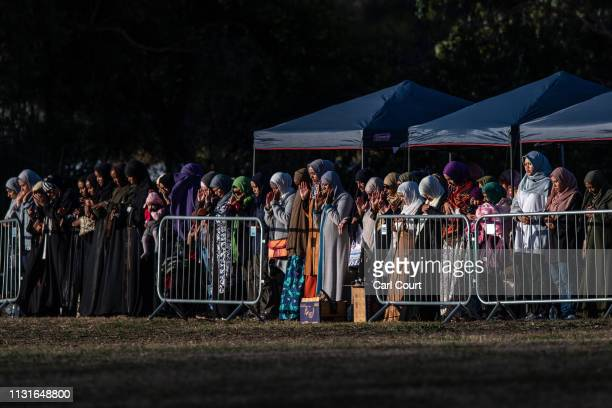 Female mourners attend the funeral of a victim of the Christchurch terrorist attack at Memorial Park Cemetery on March 20, 2019 in Christchurch, New...