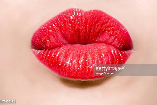 female mouth puckering - peck stock pictures, royalty-free photos & images
