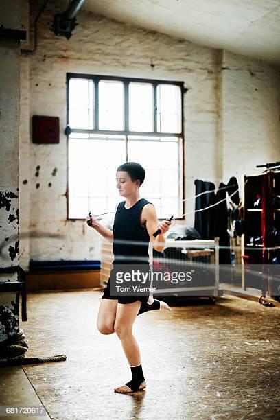 Female muay thai athlete warming up