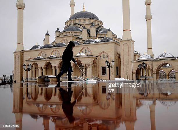 A female municipal worker cleans the square in front of Akhmad Kadyrov Central Dome Mosque known as 'Heart of Chechnya' in the Chechnya's provincial...