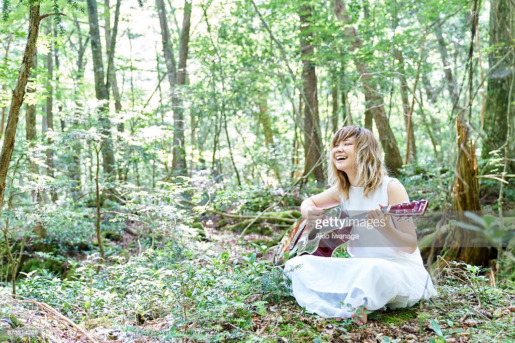 Female musicians sing in the forest : Stock Photo