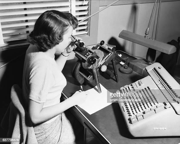 A female NASA/NACA 'human computer' uses a Friden Machine to perform mathematics calculations Langley Virginia 1955 Image courtesy NASA