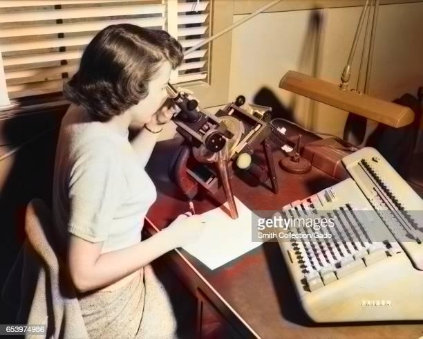 A female NASA/NACA 'human computer' uses a Friden Machine to perform mathematics calculations Langley Virginia 1955 Image courtesy NASA Note Image...