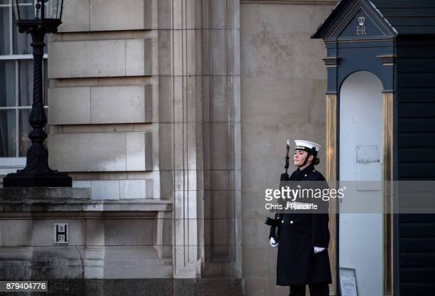 A female naval officer stands on guard at Buckingham Palace after sailors from the British Royal Navy performed their first changing of the guard...