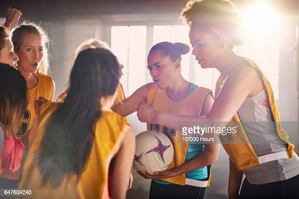 female netball team training in gym. - leisure facilities stock pictures, royalty-free photos & images