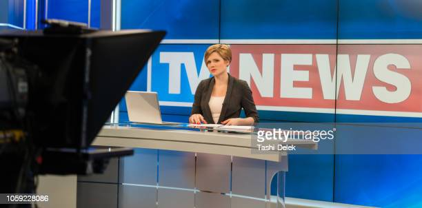 female newsreader in studio - news event stock pictures, royalty-free photos & images