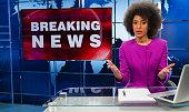 Female Newsreader In Studio