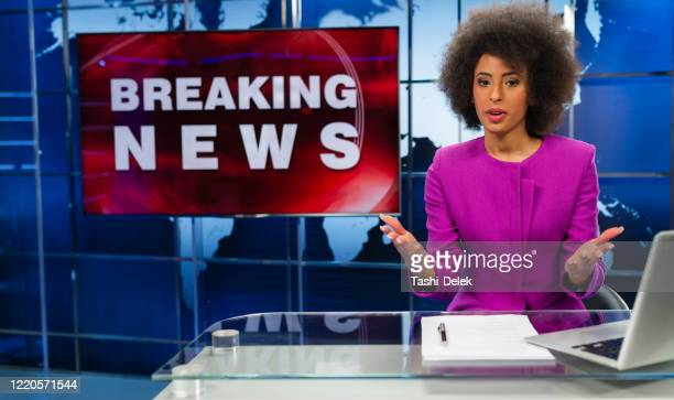 female newsreader in studio - press conference stock pictures, royalty-free photos & images