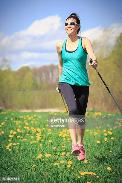 Female Nordic walker on a meadow