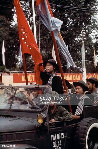 Female North Vietnamese troops enter Saigon in a jeep