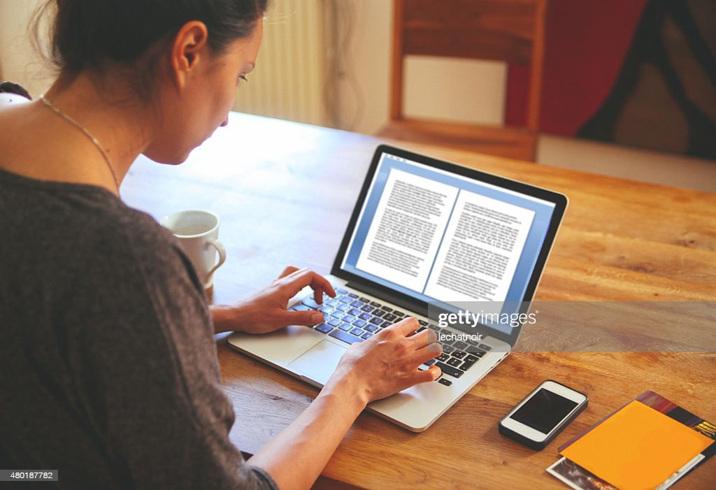 female novelist writing on the laptop stock photo getty images