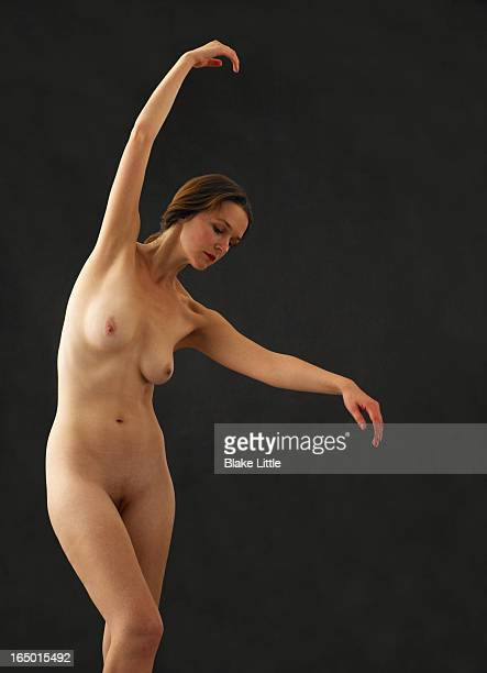 female nude dancer arms up