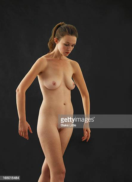 female nude dancer looking down