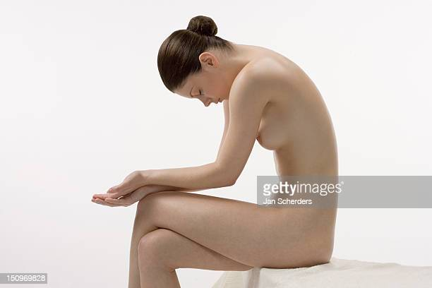 Female nude in sitting position