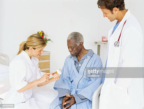 female nurse explaining to patient about their medicine