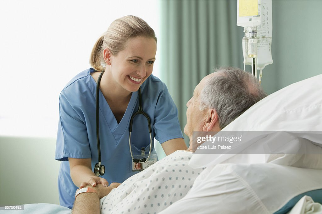 Female nurse with male patient : Stock Photo