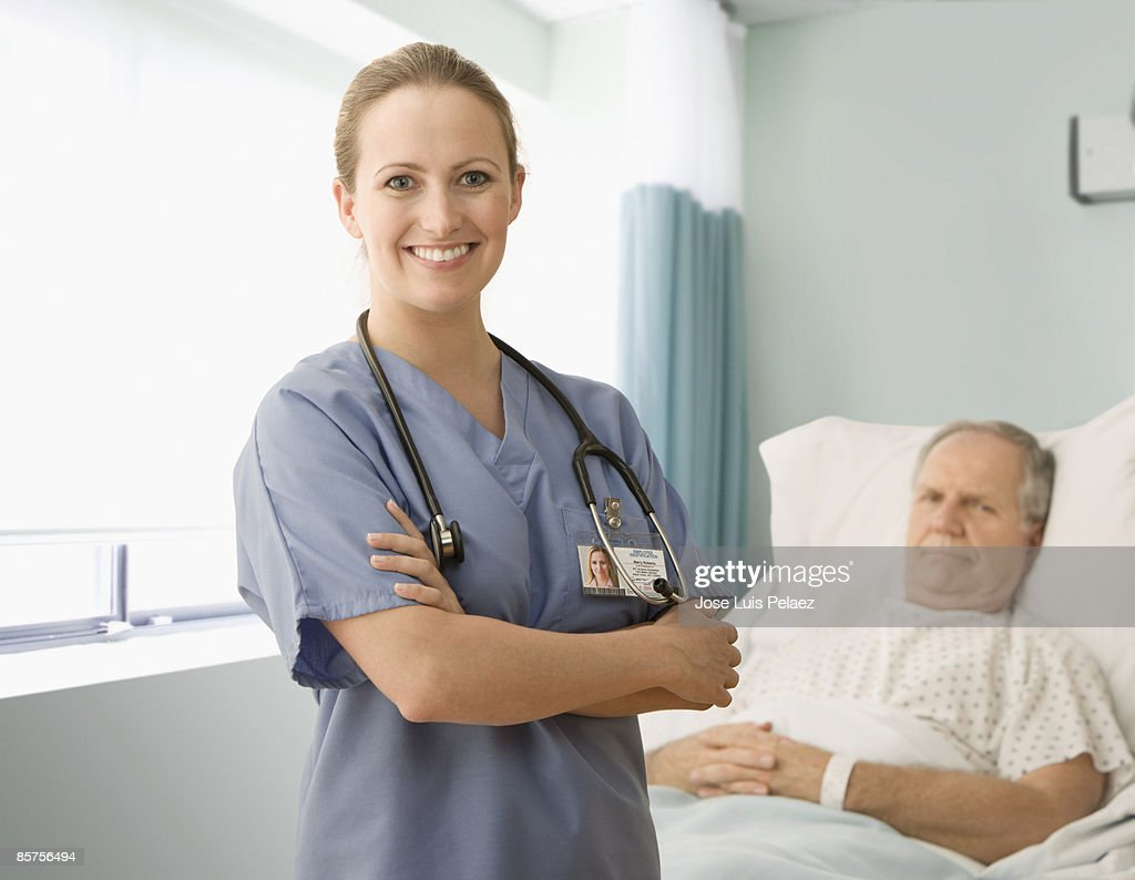 Female Nurse With Male Patient Stock Photo  Getty Images-3151