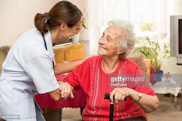 Female nurse with senior woman patient