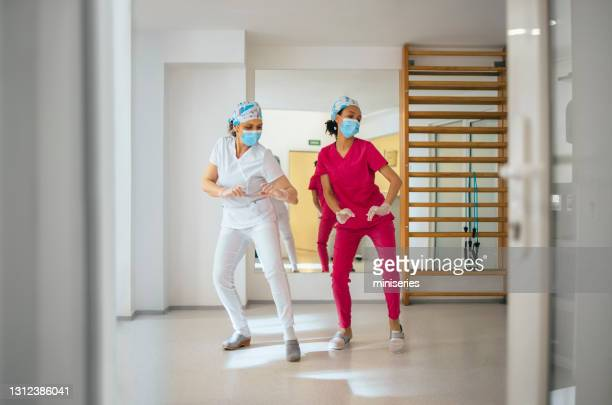 female nurses dancing and having fun at work - dancer stock pictures, royalty-free photos & images
