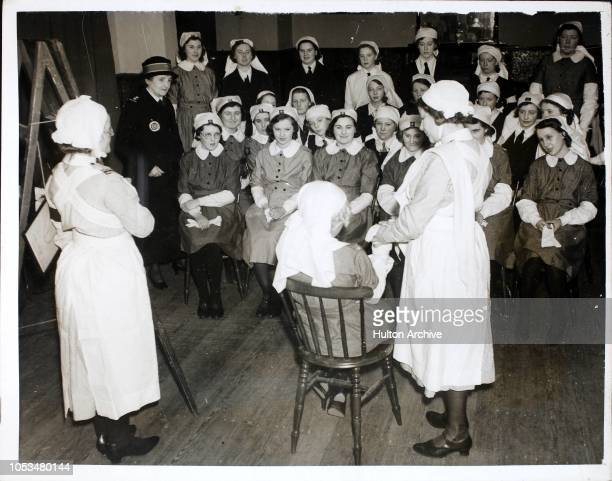 CALL Girls between the ages of 11 and 17 who are member of the Birkenhead Nursing Girl Cadets are being trained in firstaid home nursing etc at...