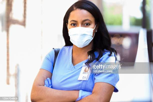 female nursing student wears protective gloves and mask - black glove stock pictures, royalty-free photos & images