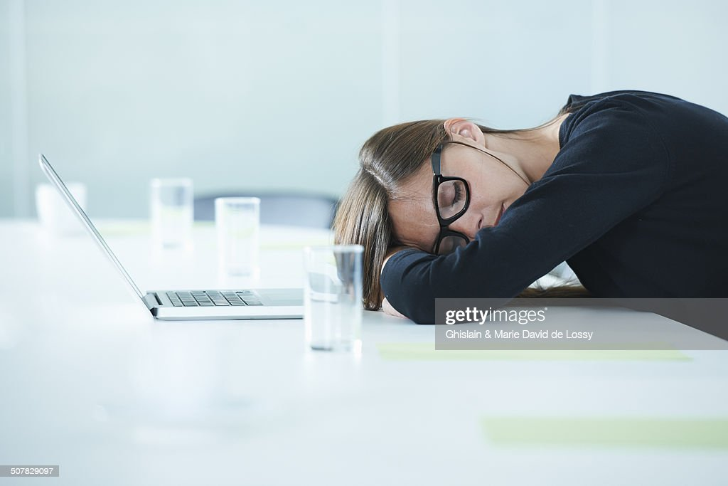 Female office worker asleep at conference table : Stock Photo