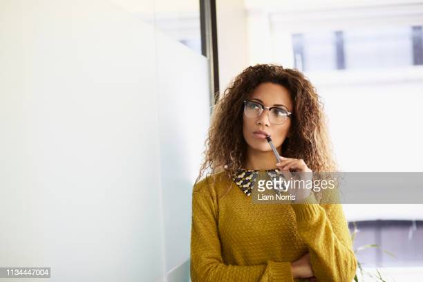 female office worker holding pen - joining the dots stock pictures, royalty-free photos & images