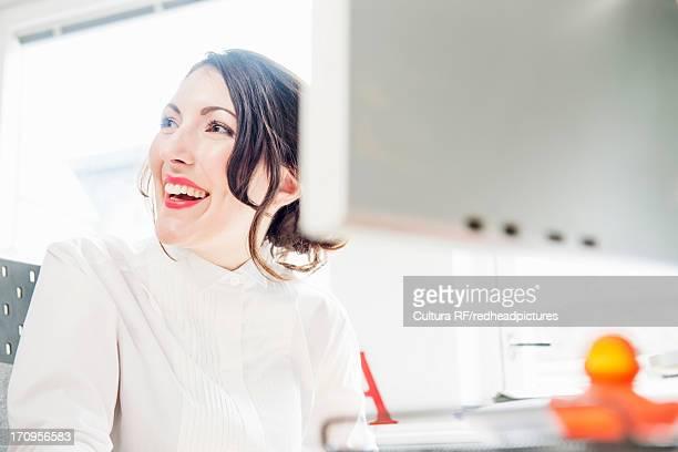 Female office worker looking away, smiling