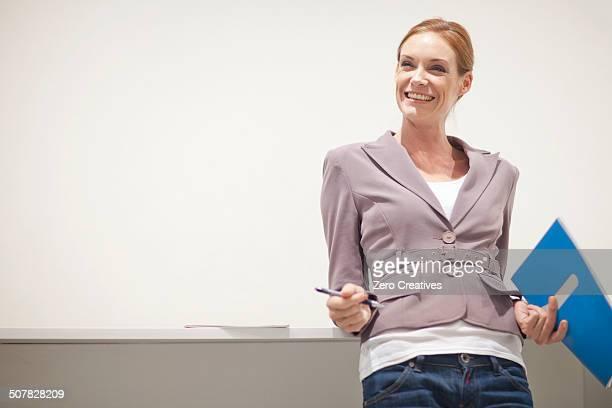 Female office worker smiling, portrait