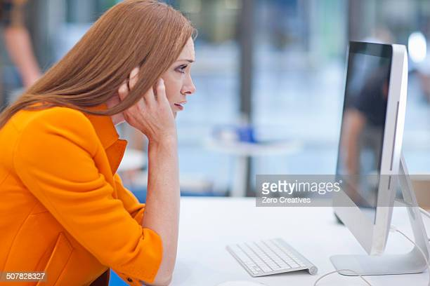 Female office worker staring at computer screen