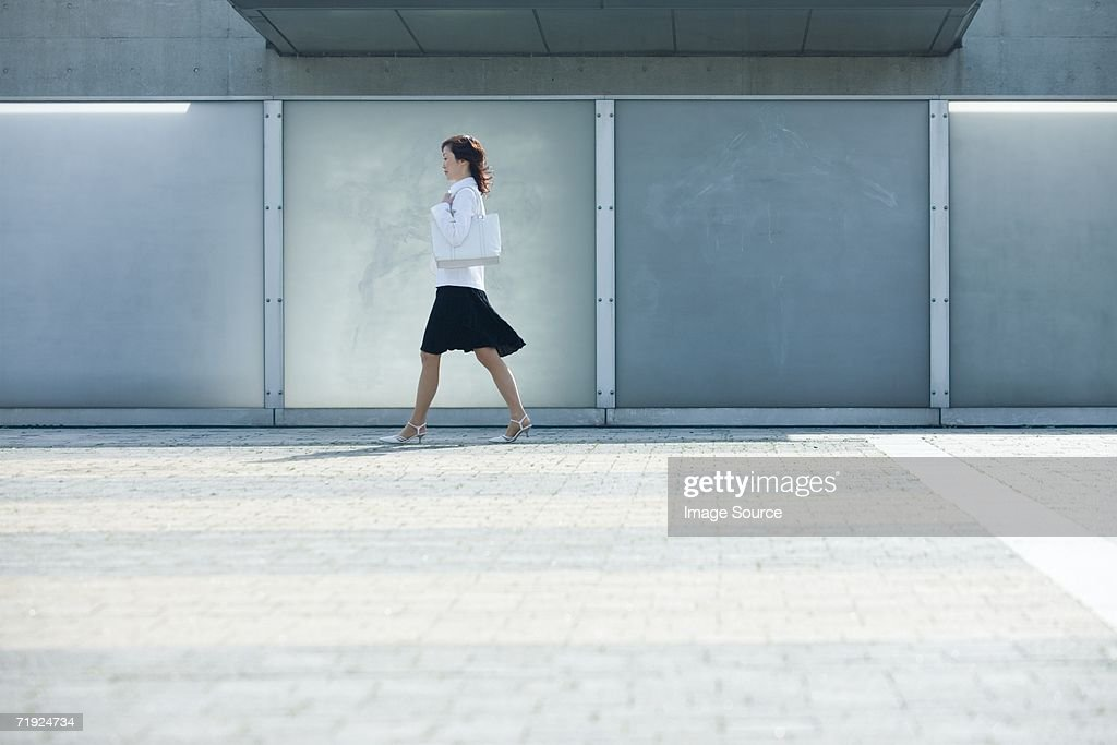 Female office worker walking : Stock Photo