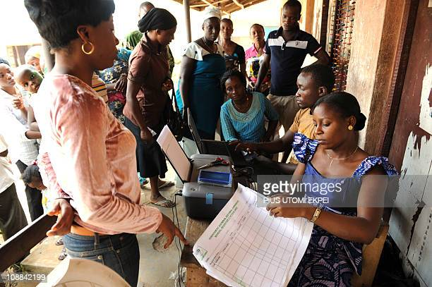A female official of the Independent National Electoral Commission registers prospective voters during a registration exercise in the Mushin distric...