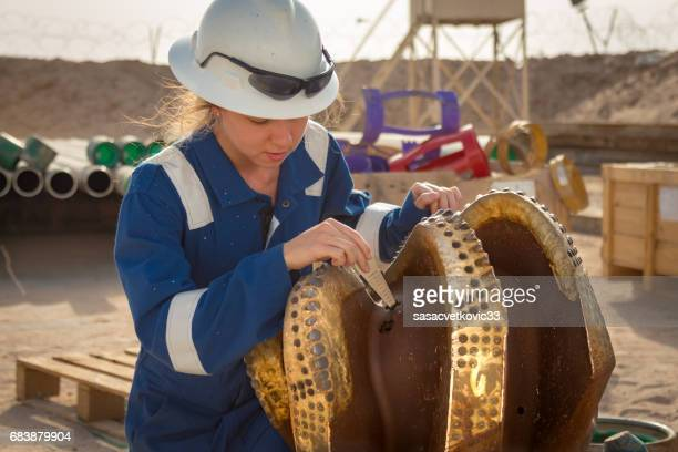 female oil engineer - drill bit stock photos and pictures