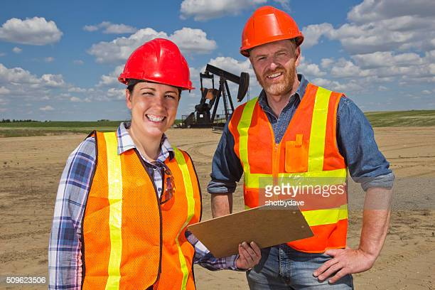 Female Oil Worker and Engineer at Pumpjack