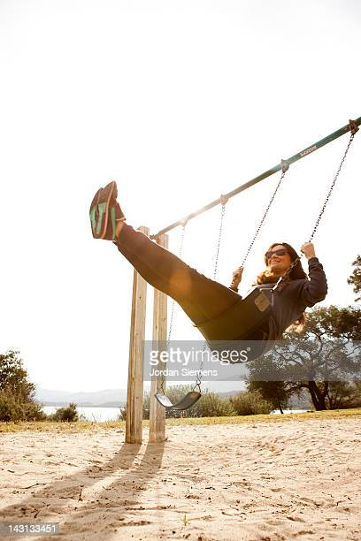 A female on a swing.