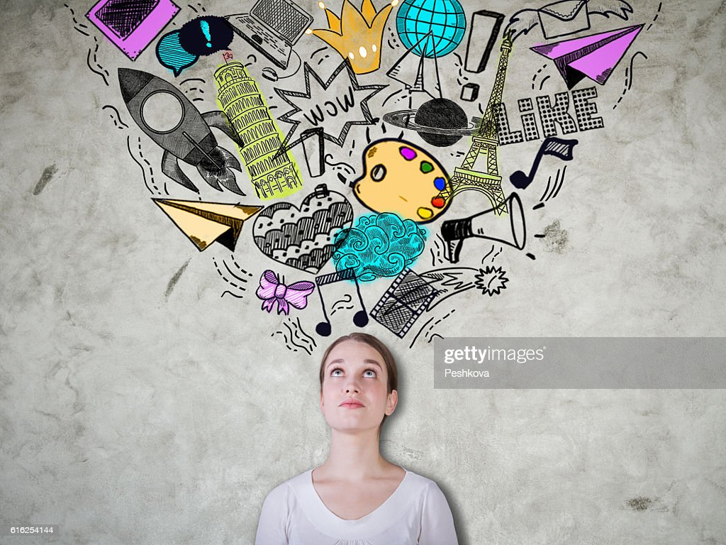 Female on concrete background with sketches : Foto de stock