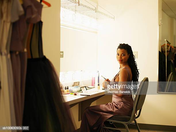 female opera singer sitting in dressing room, smiling, portrait - backstage stock pictures, royalty-free photos & images